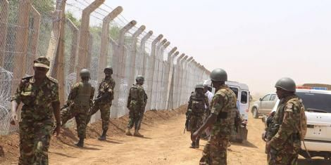 Kenya Defence Forces (KDF) soldiers inspect the security fencing at the Kenya-Somali border on February 21, 2017