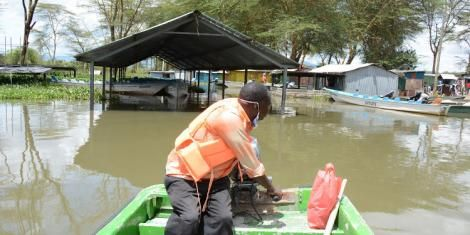 A boat operator assesses damage at Lake Naivasha's Kamere landing beach in May 2020