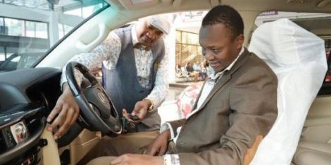 Michael Njogo Gitonga checking out a car on Wednesday, August 12, 2020.