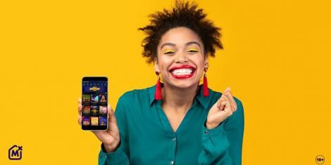 An image of a lady holding a phone