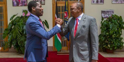President Uhuru Kenyatta with Agriculture Cabinet Secretary Peter Munya at State House