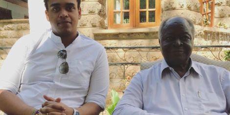 Kenya's third President Mwai Kibaki (right) with his Grandson Kibaki Junior pose for a photo at his Othaya home.
