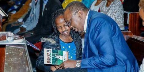 Author Natalie Wambui (left) pictured when she met President Uhuru Kenyatta in 2017