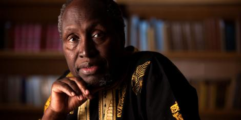 A photo of Ngugi wa Thiong'o in a library