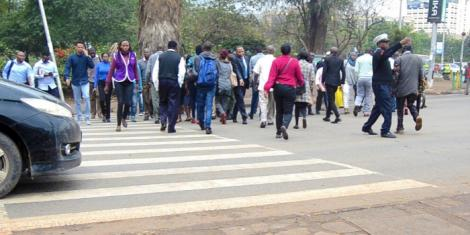 Pedestrians assisted by traffic police at a zebra crossing in Nairobi, on Monday, October 21, 2019
