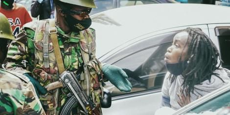 Juliet Wanjira (Right) confronts a police officer while resisting arrest during protests in Nairobi on July 7, 2020