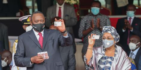 President Uhuru Kenyatta and First Lady Margaret display new Huduma Cards at Gusii Stadium on Tuesday, October 20, 2020.