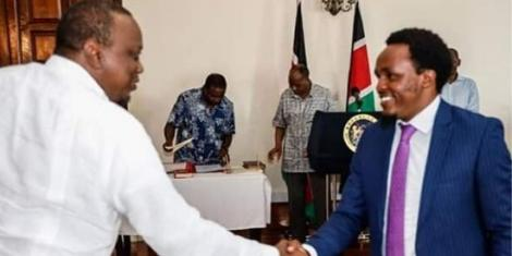 President Uhuru Kenyatta greets Zachary Kinuthia during his appointment as Chief Administrative Secretary (CAS) in the Ministry of Education on January 14, 2020.