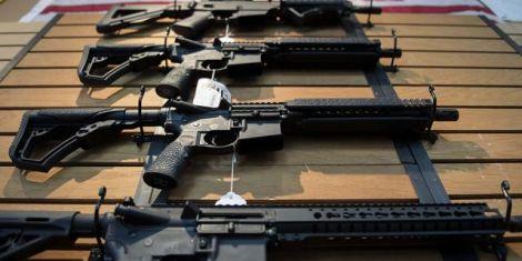 Several guns laid on a table