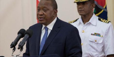 File image of President Uhuru Kenyatta with his personal aide Timothy Lekol