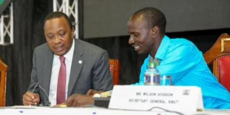 From left to right: President Uhuru Kenyatta and KNUT Secretary General Wilson Sossion.