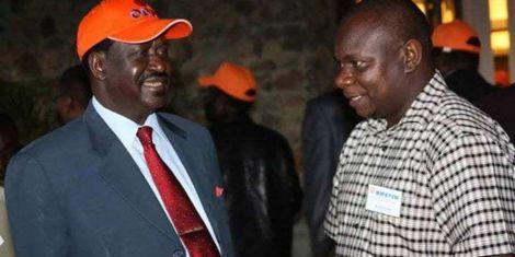 ODM Party Leader Raila Odinga with ODM Communication Director Philip Etale. Photo undated.