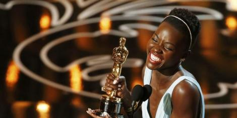 Actress Lupita Nyong'o gives an address after winning best supporting actress at 86th Academy Awards.