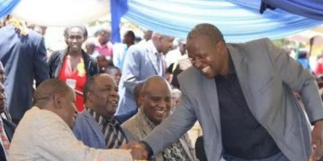 KNUT National Treasurer John Matiang'i greets his brother Interior CS Fred Matiang'i at a previous function