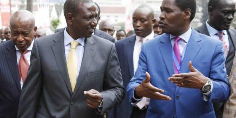 Agriculture CS Peter Munya and Deputy President William Ruto engage in a conversation in a past event