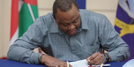 President Uhuru Kenyatta signs into law the Finance Bill 2020 at State House, Nairobi on Tuesday, June 30, 2020