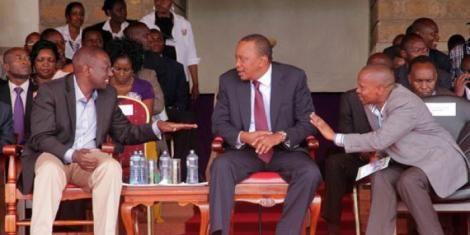 President Uhuru Kenyatta (centre) with DP William Ruto (left) and Tharaka Nithi Senator Kithure Kindiki (right) during a political event.